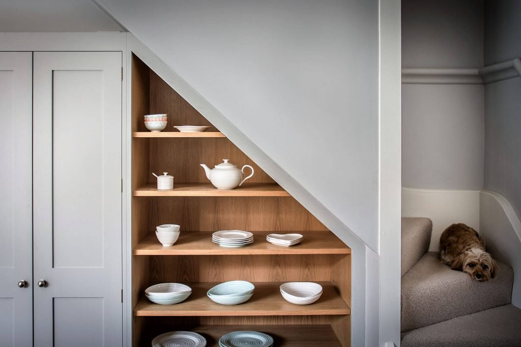 Rockhouse Barn conversion Shaker Kitchen with built in angled under stair shelving cabinet