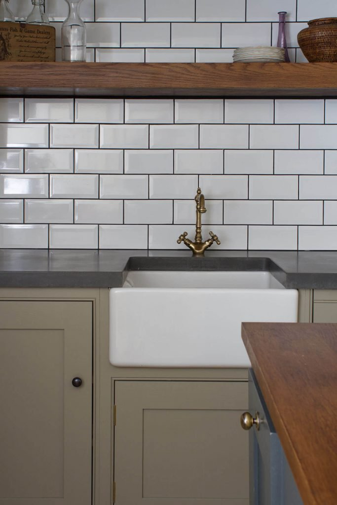 18th century manor house kitchen traditional Belfast sink, concrete worktop and metro tile splashback