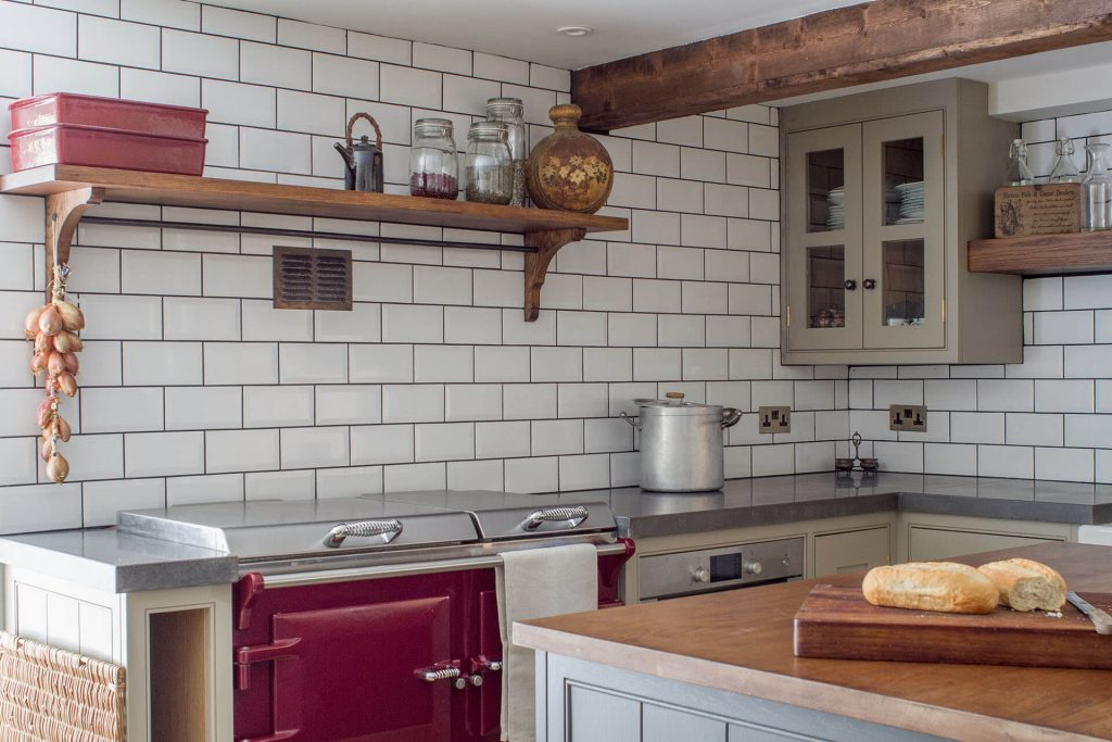 18th century manor house kitchen with Everhot electric range cooker and polished concrete worktop