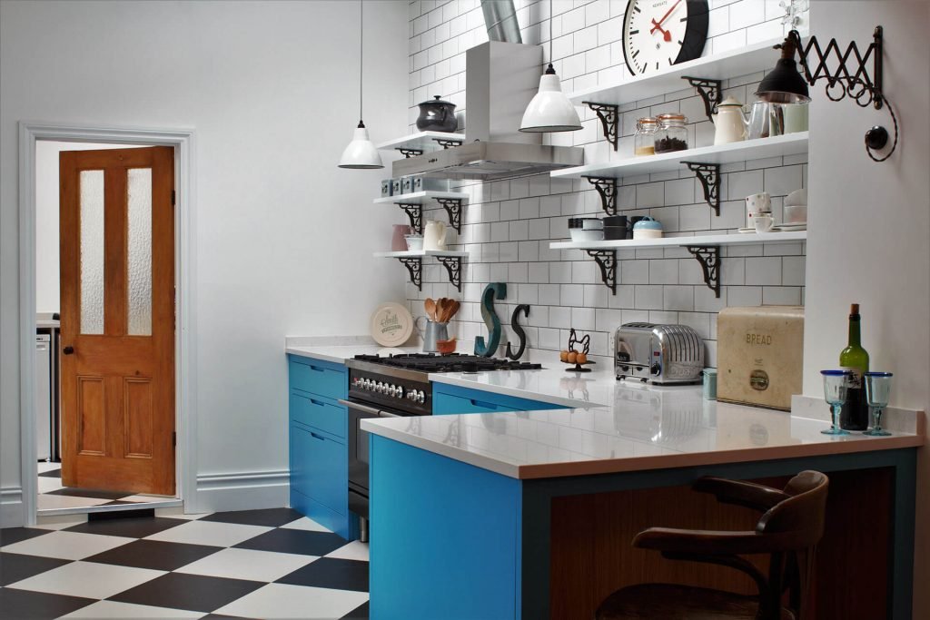 American Diner Style Industrial Kitchen feel and peninsular breakfast bar with bar stools
