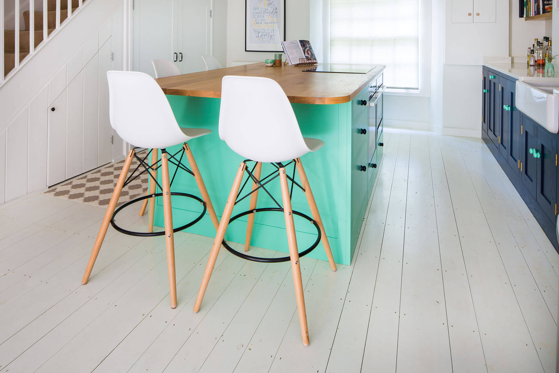 Colourful fun Shaker kitchen with bar stools and Oak worktop