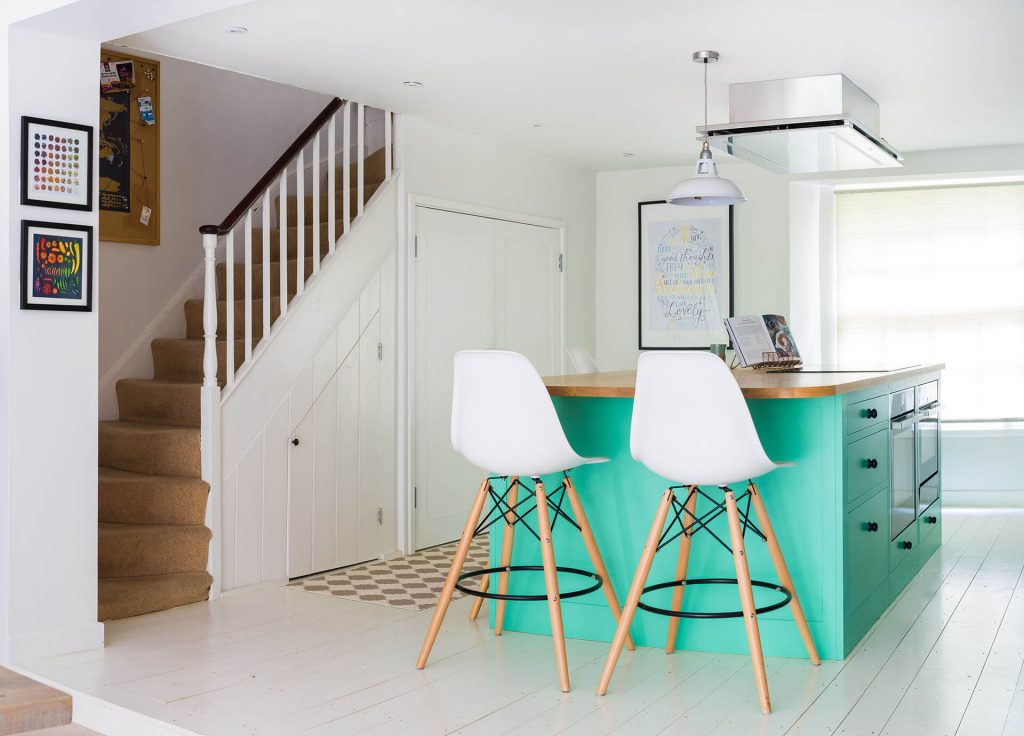 Colourful fun Shaker kitchen with painted pine floor and Green Verditer cabinets
