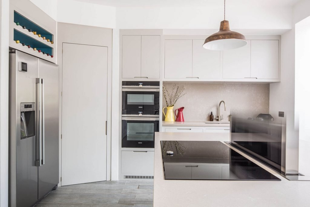 Contemporary kitchen with walk in larder and Bosch American fridge freezer and downdraft extractor