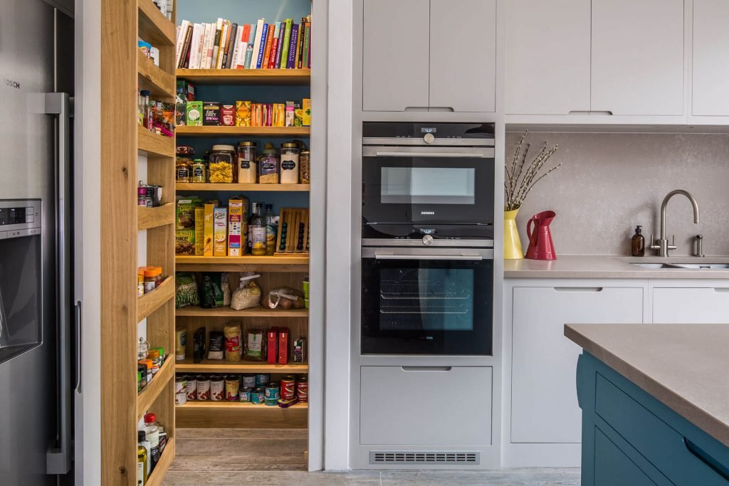 Contemporary kitchen with walk in larder and food racks