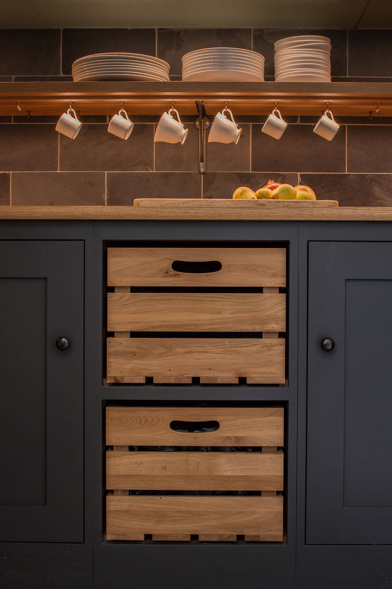 Cotswold Chapel Kitchen with Oak crates and bespoke floating shelf with LED lighting