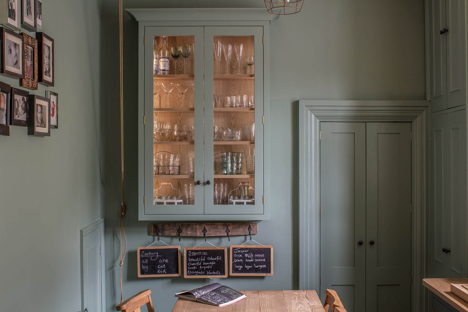 Cotswold Chapel Kitchen with green walls and bespoke glazed cabinet