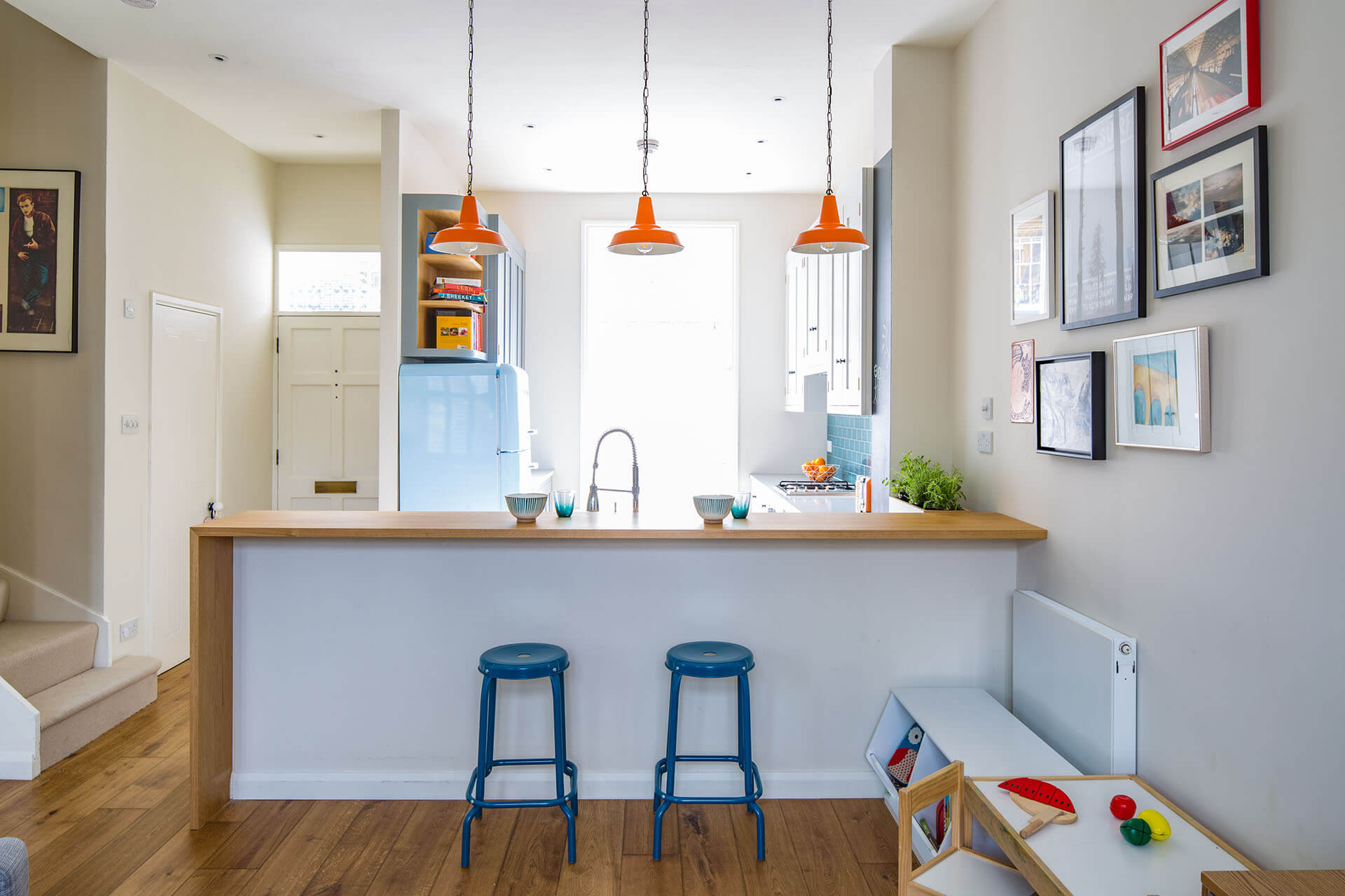 Quirky retro Shaker kitchen breakfast bar seating and Mullan Hex pendant lights