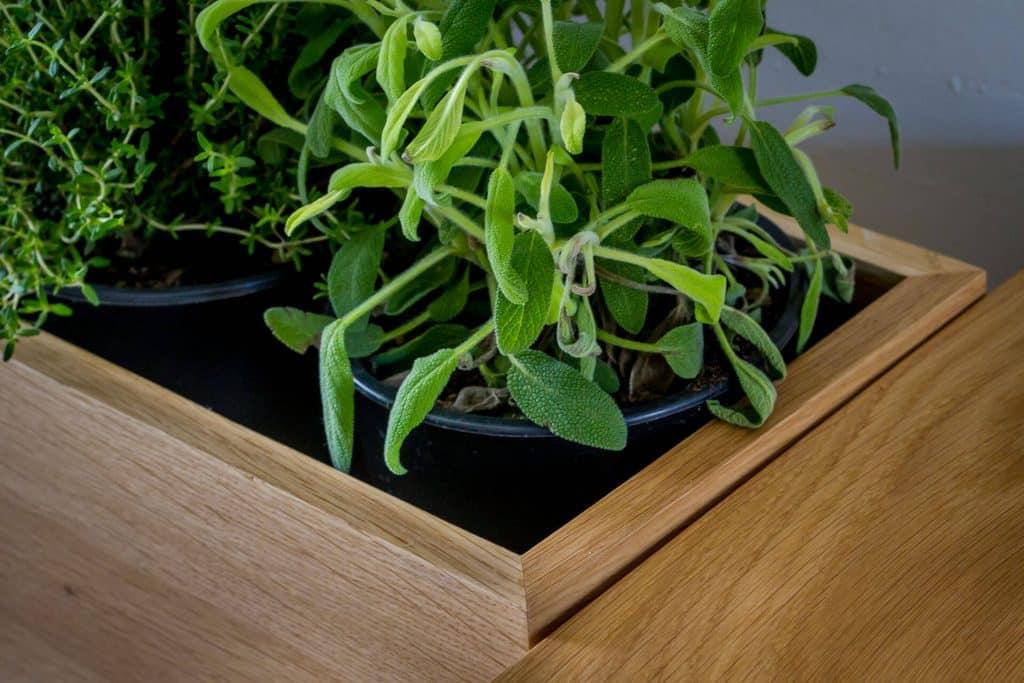 Quirky retro Shaker kitchen with bespoke Oak window planter