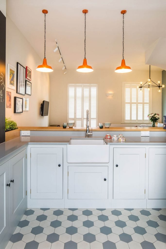 Quirky retro Shaker kitchen with quartz worktop and Mullan hex pendant lighting