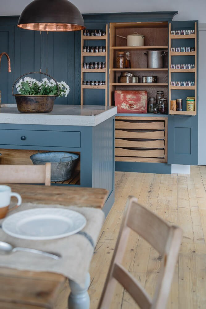Sustainable Kitchens Showroom with tall larder storage cabinet and internal spice racks