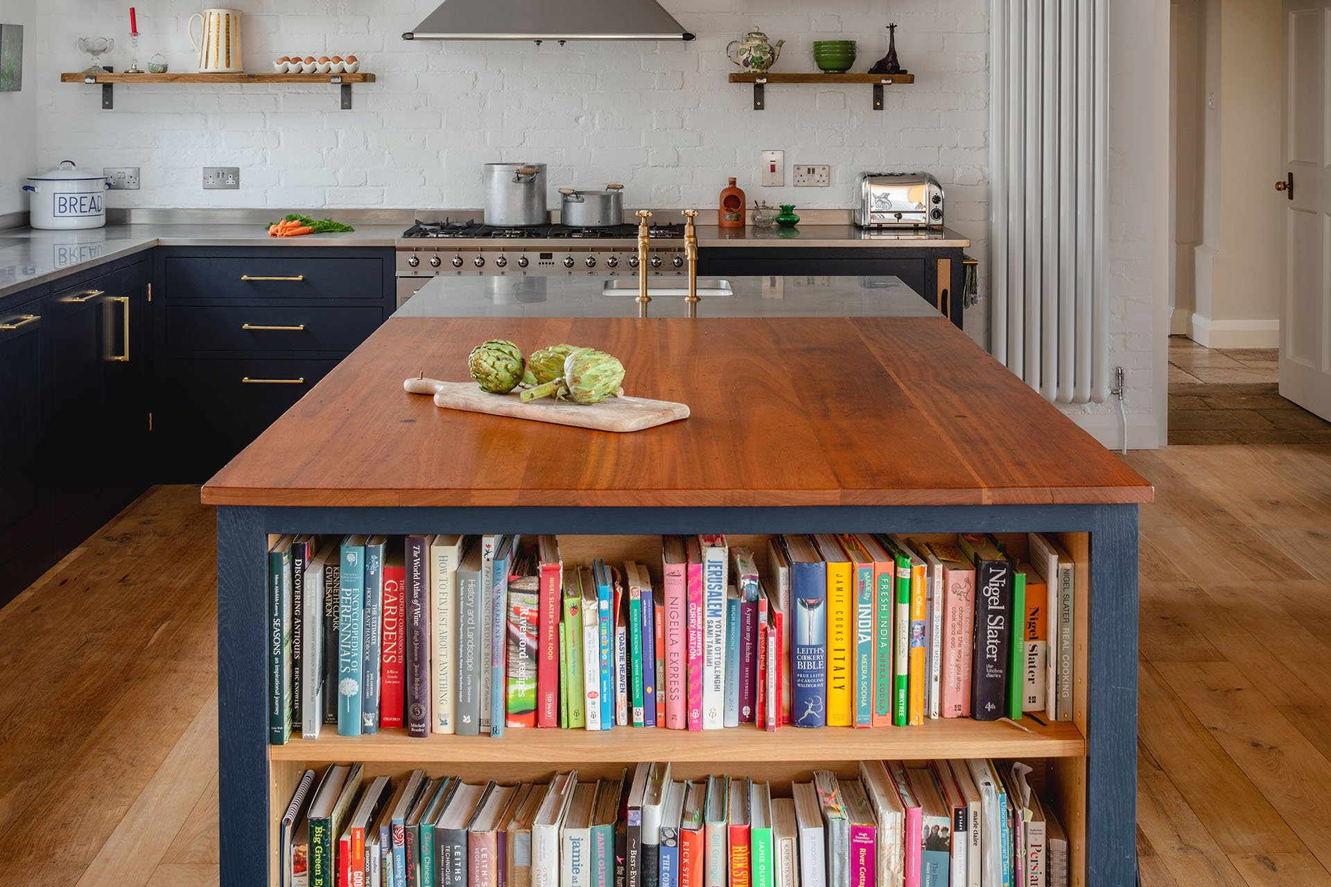 Eco Extension Shaker Kitchen cookery books and vegetables on a reclaimed wooden worktop