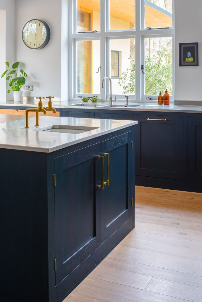 Eco Extension Shaker Kitchen recessed ceramic sink on stainless steel worktop with gold taps