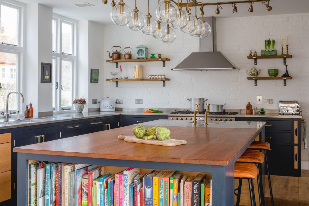 Eco Extension Shaker Kitchen vintage lighting, plants and vegetables on the bespoke island unit made from reclaimed wood and stainless steel