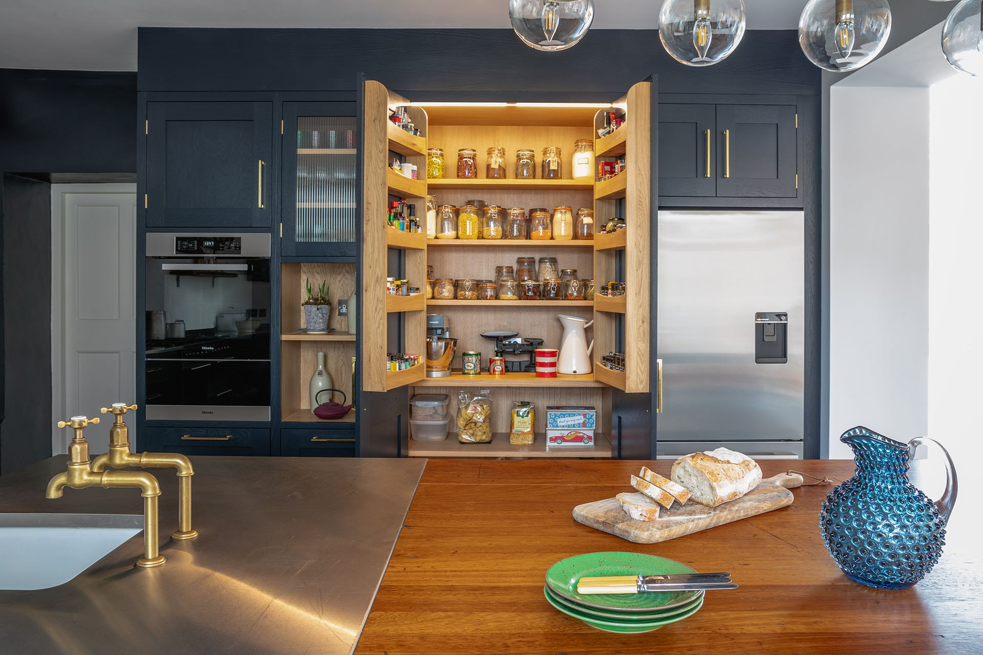 Eco Extension Shaker Kitchen with light up pantry, sourdough bread and exposed appliances
