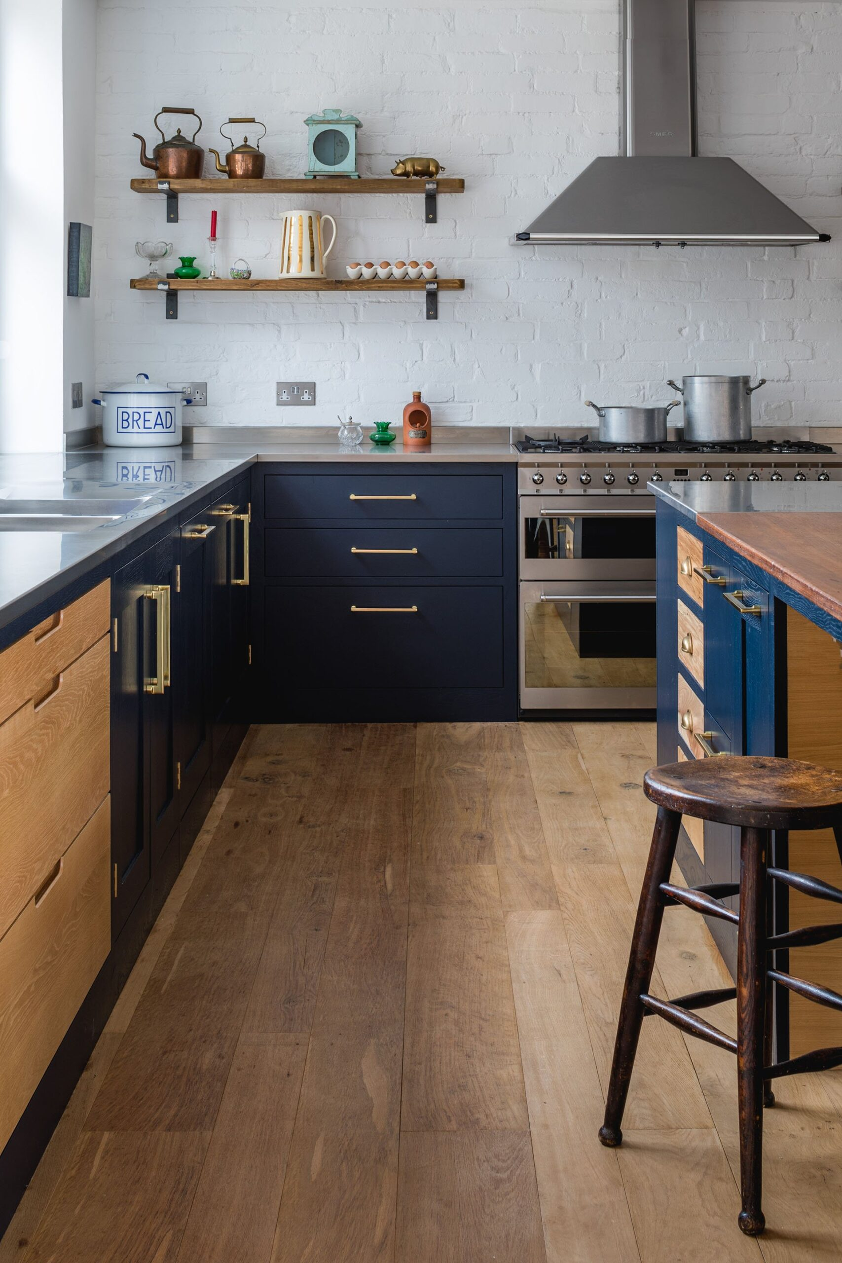 Eco Extension Shaker Kitchen with vintage wooden stool, stainless steel worktops and interesting timber drawers