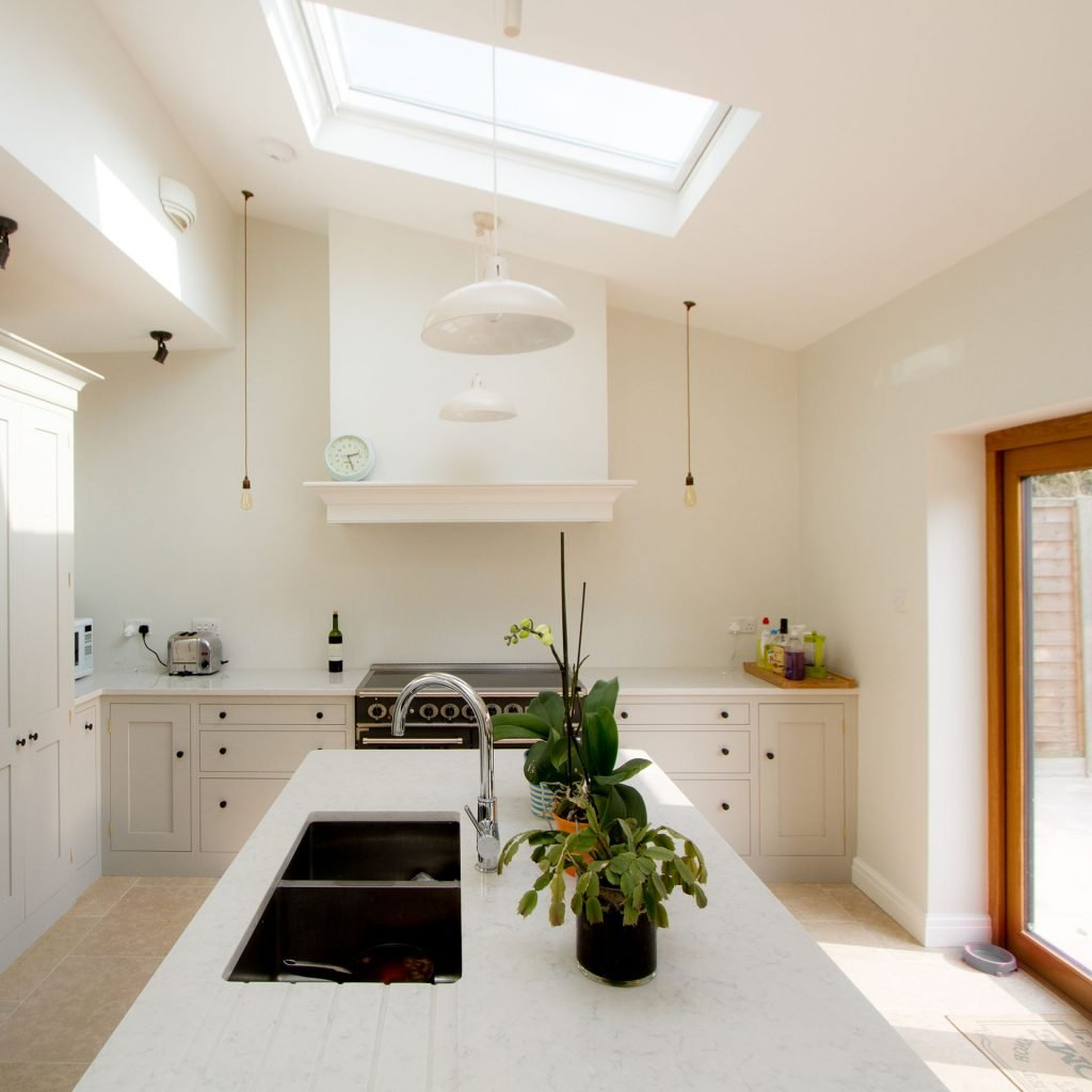 Stunning Shaker Kitchen with large kitchen island and white marble worktops and plants