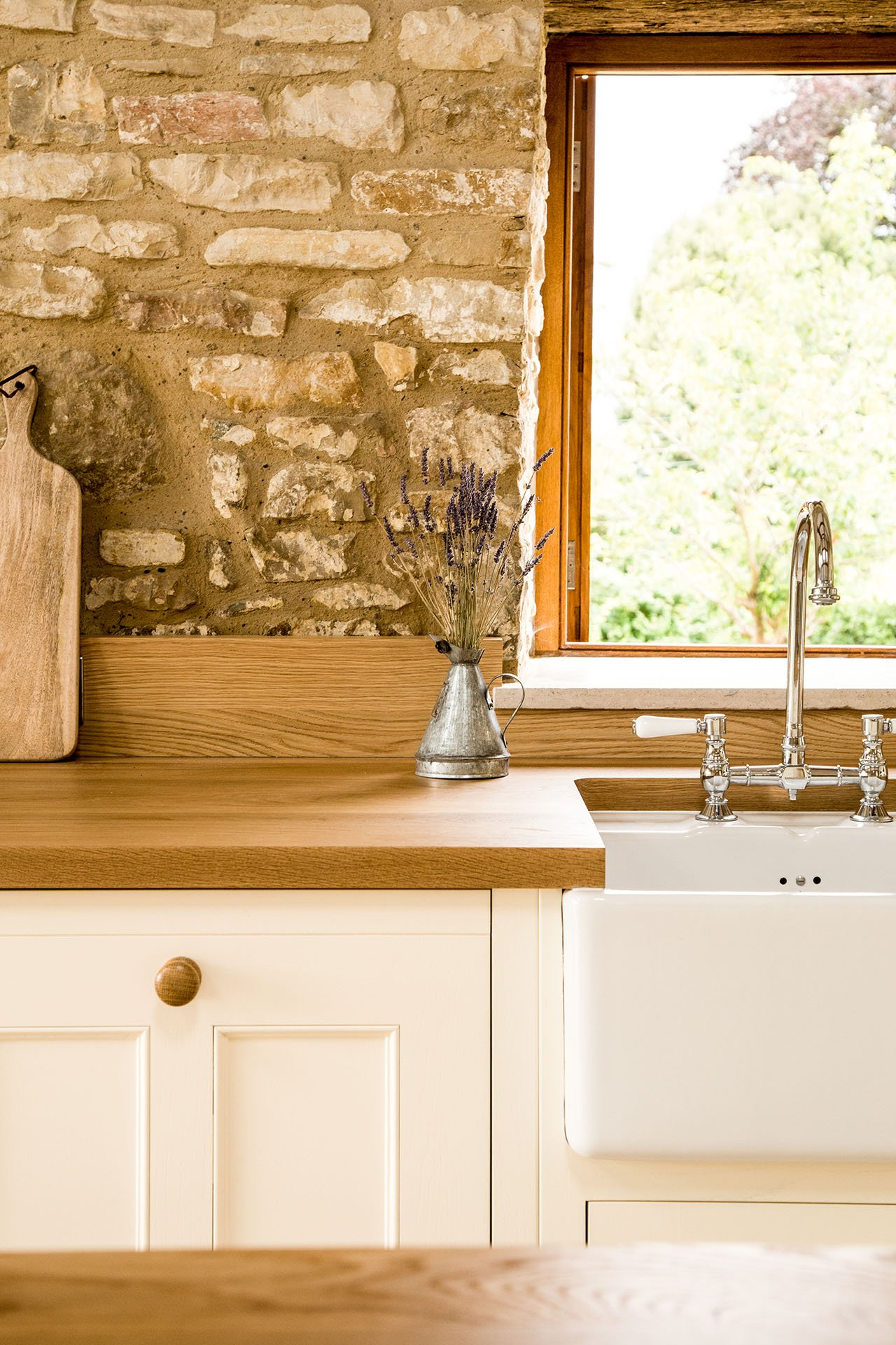 Traditional Country Kitchen with Oak worktop and white painted cabinets with moulded panels
