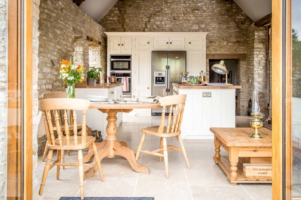 Traditional Country Kitchen with glazed patio doors