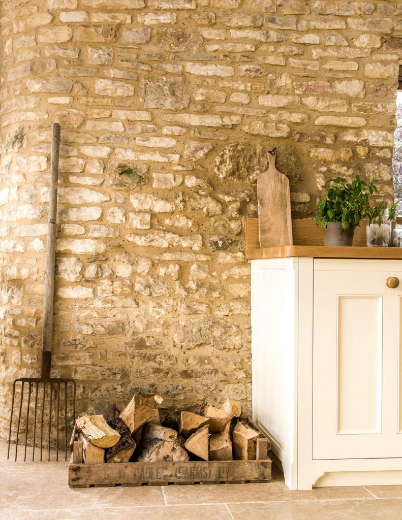 Traditional Country Kitchen with natural stone wall
