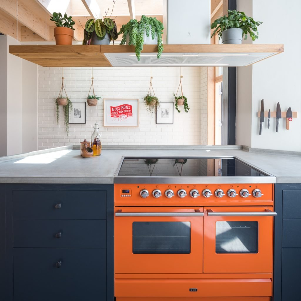 The loft kitchen Ilve Roma range under Elica bio island extractor fan with extended shelf and plants