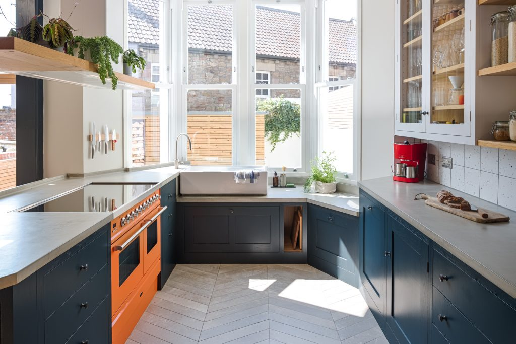 The loft kitchen breakfast nook with coffee and toast and Ilve Roma range in charlottes locks orange