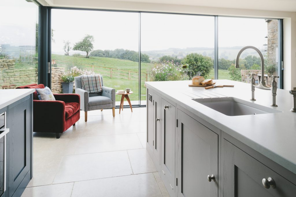 MANOR FARM KITCHEN - barn convertion overlooking fields with central island, aga in farrow and ball