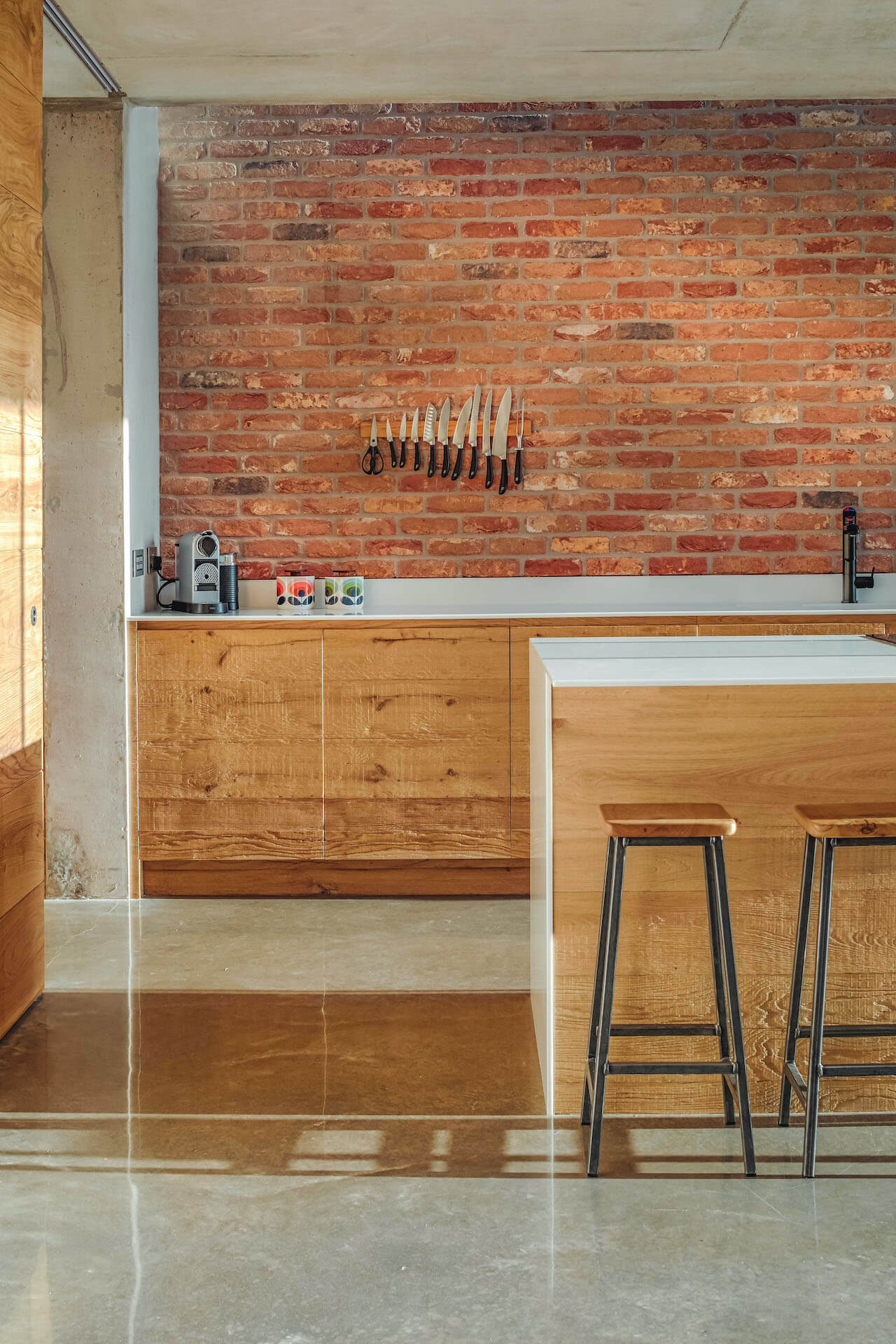 Industrial, reclaimed wood kitchen with concrete and brick