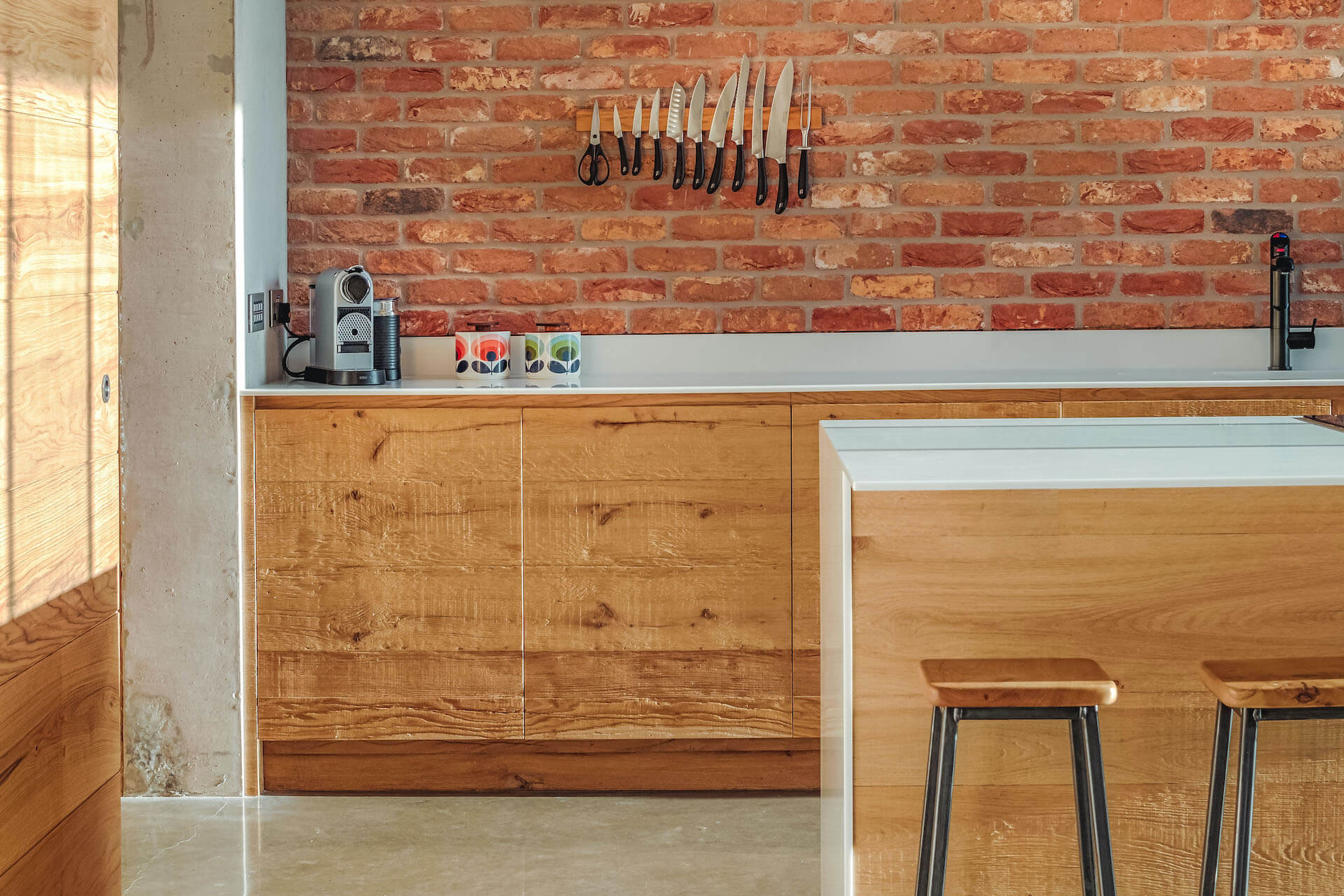 Industrial, reclaimed wood kitchen with concrete and brick from Sustainable kitchens