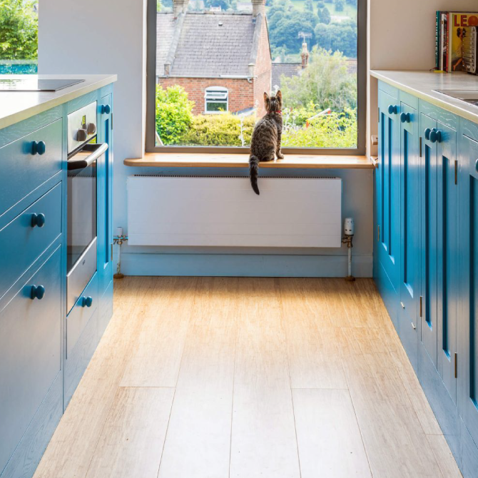 Stroud blue shaker kitchen with integrated island hob and oven