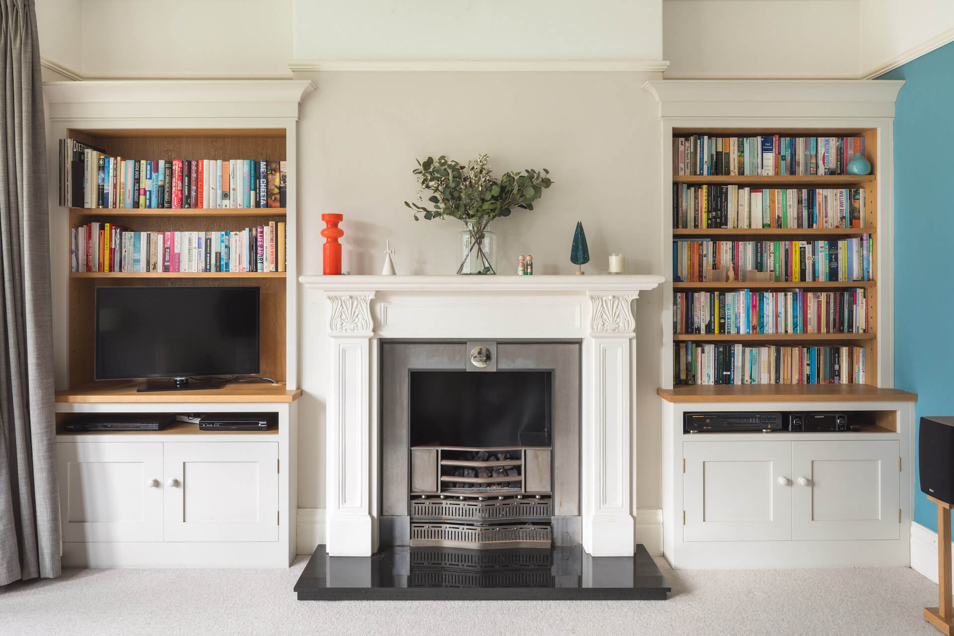 Alcove Storage sustainable cabinetry with built in tv units and bookshelf