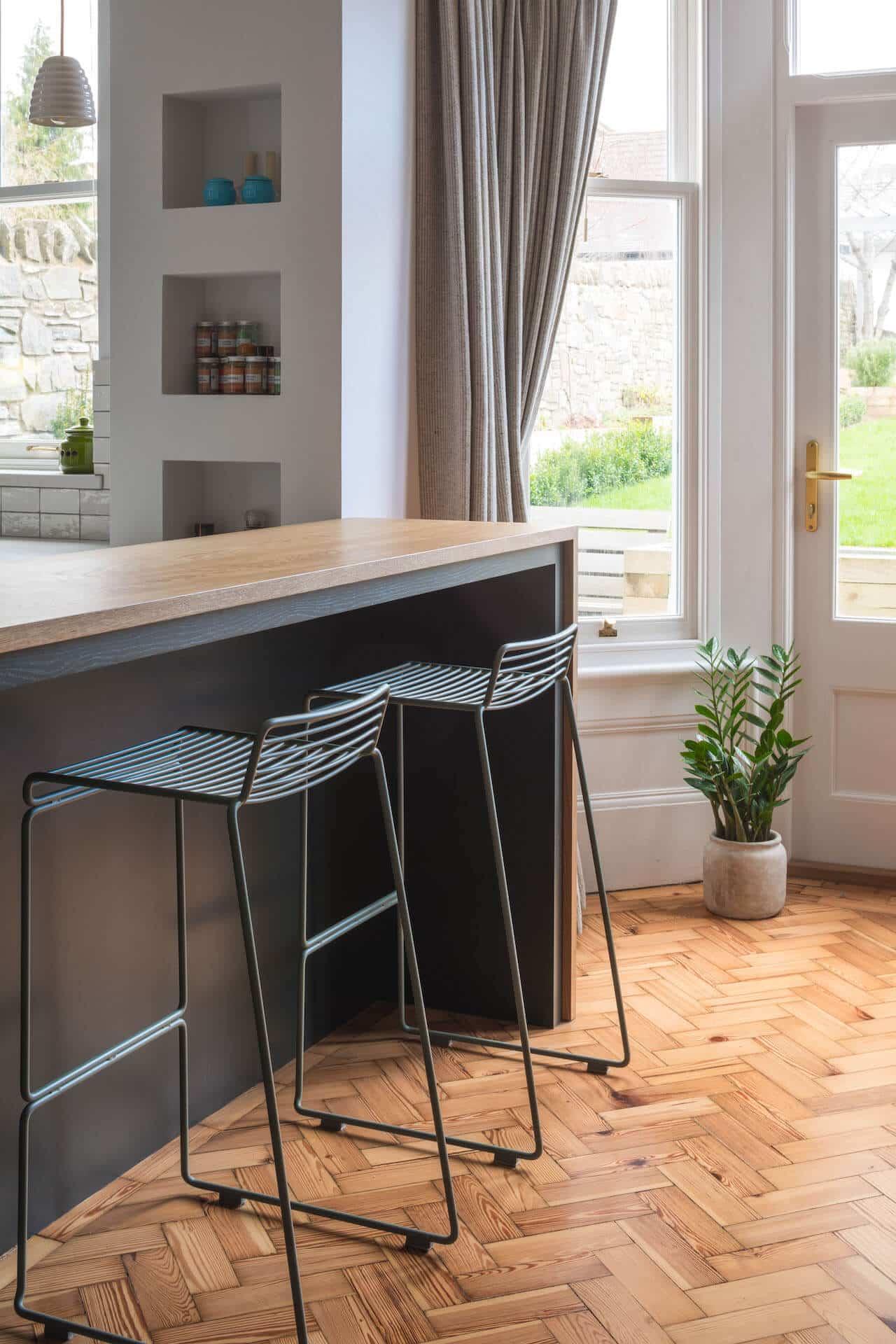 The Cardiff Green Shaker Kitchen with Oak breckfast bar peninsular