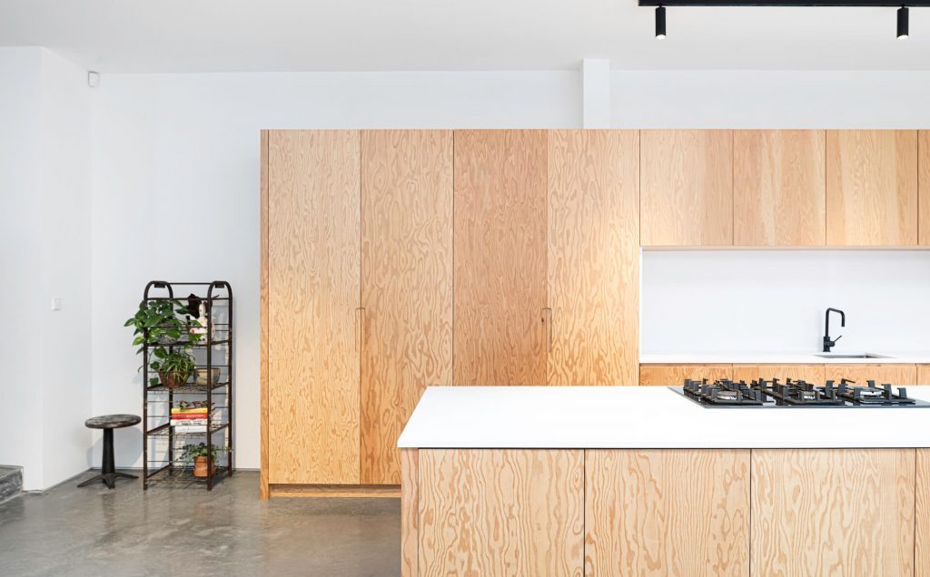 Douglas Fir Plywood Kitchen with white walls and polished concrete floor Sustainable Kitchens