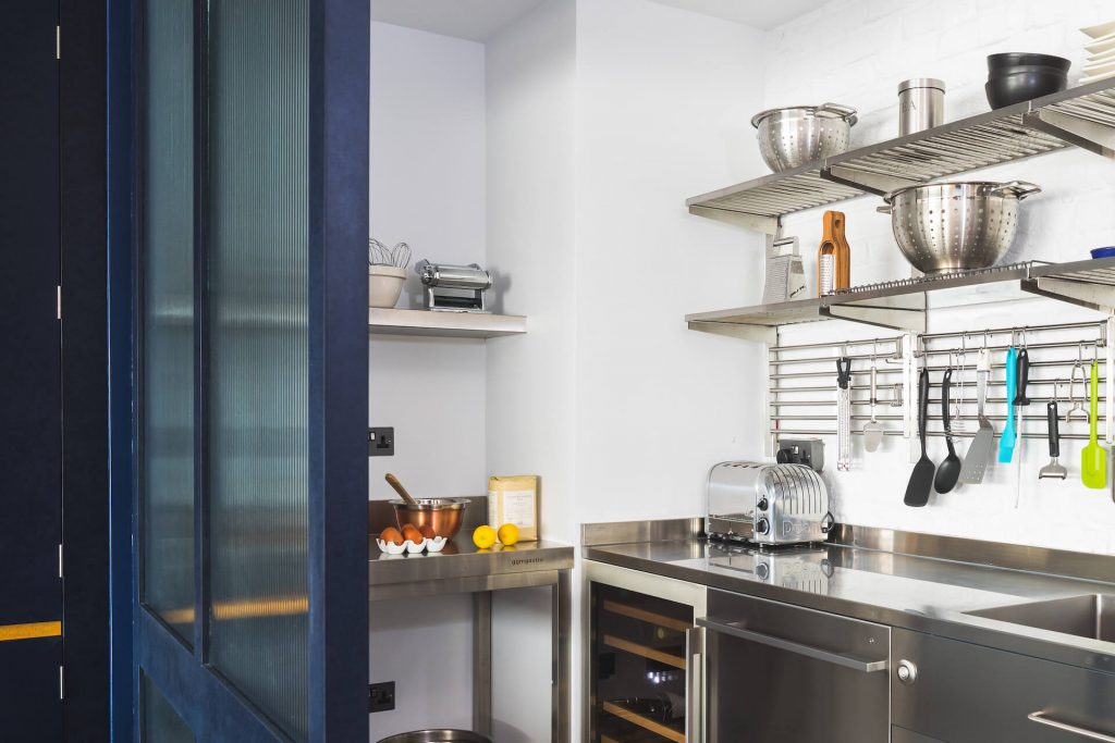 The Richlite Kitchen with reeded glass screen, stainless steel rear kitchen